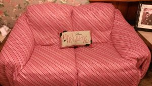 Bought 4 yds of candy cane print fleece from Joanns and covered the couch with it
