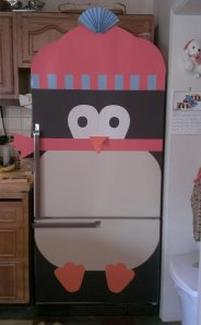 Used construction paper and double sided tape to create the penguin fridge!