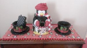 Made a cute penguin print table runner and got those cute top hat baskets from Michaels